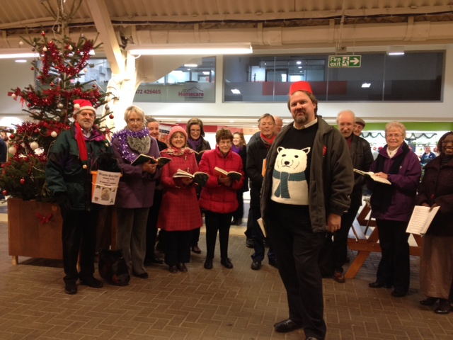 Carol Singing to raise money for St Andrew's Hospice, Grimsby. December 2014 on Freeman Street Market.